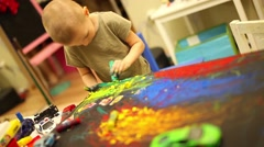 Child boy draws paint Stock Footage
