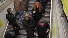 People getting up from suway in London Stock Footage