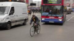 Man on a bike in London Stock Footage