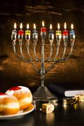 Jewish Holiday Hanukkah With Menorah, Torah, Donuts And Wooden Dreidels Stock Photos