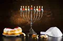 Jewish Holiday Hanukkah With Menorah, Torah, Donuts And Wooden Dreidels - stock photo