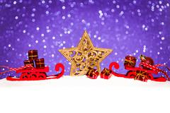 christmas star in snow on glitter background - stock photo