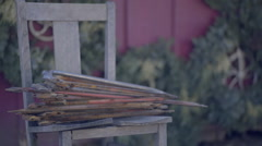 Stack Of Old Saws (For Cutting Down Christmas Trees) In Front Of Red Barn Stock Footage