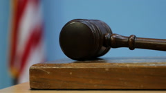 Gavel Forcefully Striking Sound Block with American Flag in Background Stock Footage
