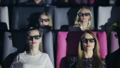 Group of people in 3D glasses watching a movie at cinema - stock footage