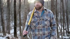 Lumberjack Leaves Forest After Long Day of Chopping Trees - stock footage