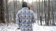 Lumberjack Walking Into Forest with Axe - stock footage