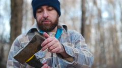 Lumberjack Checks Axe - stock footage