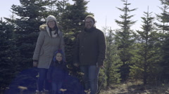 Happy Family Smile And Pose With Their Christmas Tree, Before They Cut It Down Stock Footage