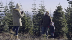 Woman Takes Photo Of Her Family Posing In Front Of Their Christmas Tree Before Stock Footage