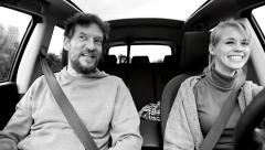 Black and white portrait of happy couple driving car Stock Footage