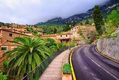Mountain road winding through little spanish town, Spain Stock Photos