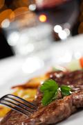 Stock Photo of closeup of a steak with blurry background