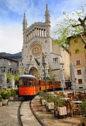 Old tram in front of the Cathedral of Soller, Mallorca, Spain Stock Photos