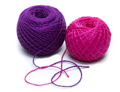 tangle of colored thread for tatting. White background - stock photo
