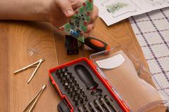 solders a LED fir-tree - stock photo