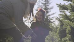Little Boy Runs Through Christmas Tree Farm, His Mom Surprises Him, They Laugh Stock Footage