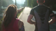 healthy couple jogging - stock footage