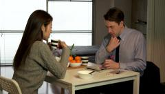 Mixed Couple Young Man And Woman Having Breakfast In Kitchen Stock Footage