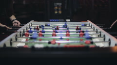 Friends having fun together playing table football Stock Footage