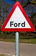 Road warning sign, ford. - stock photo