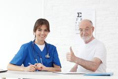 Patient getting new glasses Stock Photos