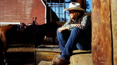 Portrait Canada BC female Cowgirl on Dude Ranch relaxing by cabin Stock Footage