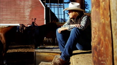 Portrait of American female Cowgirl on Dude Ranch relaxing by cabin - stock footage