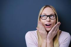 Happy Surprised Woman Against Gray Wall Stock Photos