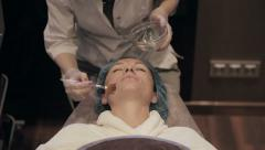 Beauty salon, facial peeling mask with retinol and fruit acids - stock footage