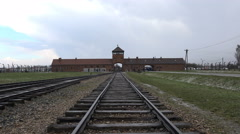 Auschwitz - Birkenau concentration camp main gate rail - Poland - stock footage