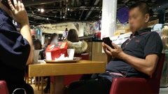 People  talking browsing  smartphone while sitting in cafe Stock Footage