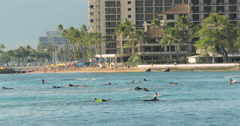 WAIKIKI BEACH, HAWAII -CIRCA DECEMBER 2015: People surfing Stock Footage