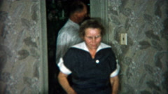 1954: Old family members making way to the dinner table for a celebration. Stock Footage