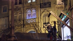 people climbing street stairs at night - stock footage