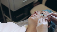 A woman is getting a mesotherapy of her face Stock Footage