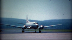 1965: Convair CV-540 Allegheny Airlines propeller airplane taxis across airport. Stock Footage