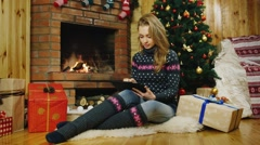 Girl with tablet near Christmas trees Stock Footage