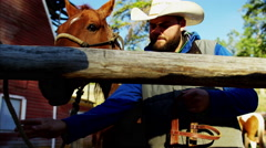 American male horse Rider on Dude Ranch in Corral Stock Footage