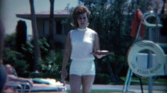 1965: 60's hairdo poolside cocktail waitress at the Sands Casino. LAS VEGAS - stock footage