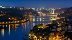 City of Porto and Gaia at night by the Douro river timelapse in Portugal Stock Footage