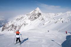 Skier preparing to descend - stock photo