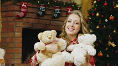 A beautiful girl with lots of teddy bears Stock Footage