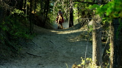 Horses galloping in Roundup on Dude Ranch with cowboy and cowgirl riders - stock footage