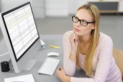 Concerned businesswoman trying to solve a problem Stock Photos