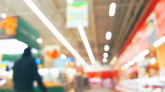 Supermarket store motion people, blur background with bokeh Stock Footage
