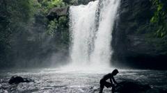 Teen having fun on waterfall Stock Footage