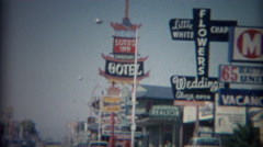 1965: 60's retro business strip motor hotels best western Lotus Inn signs.   - stock footage