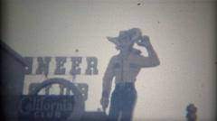 1965: Pioneer Club Vegas Vick giant cowboy neon advertisement signage. LAS VEGAS - stock footage