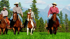 Male and female horse riders Kootenay National Park Mountain Range and trail - stock footage